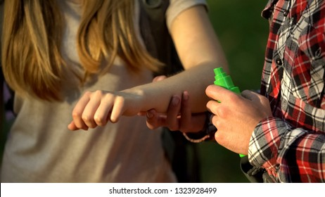 Man applying cooling cream on ladys arm after mosquitoes bite, insect repellent
