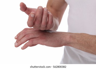 Man applying moisturizer cream on hands, dry skin on white background. Dermatology, cold weather skin care concept