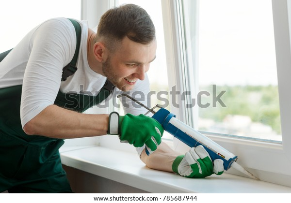 Man Applying Silicone Sealant Between Window Stock Photo (Edit Now