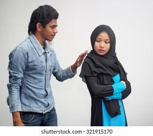A man approaching a young girl