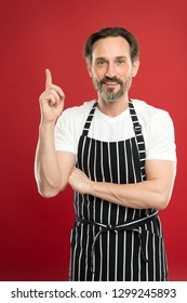 Man in apron. Confident mature handsome man in apron red background. He might be baker gardener chef or cleaner. Good in everything. Multitasking and professional occupation. Apron for dirty work.