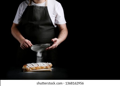 man in apron serving strudel. recipe of strudel or pie. baker decorating concept.