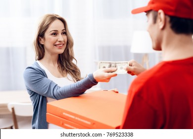 A man of Arab nationality works on the delivery of pizza. The girl ordered the delivery of pizza. Pizza deliveryman brought an order to the house.