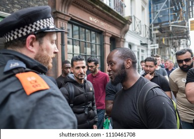 A man argues with the police during the Al Quds Day rally, London, 10/06/18.