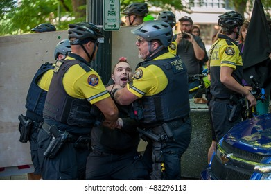 A man is arrested by elements of the bicycle police during the March to End Prison Slavery in downtown Portland, OR. 9/9/2016.