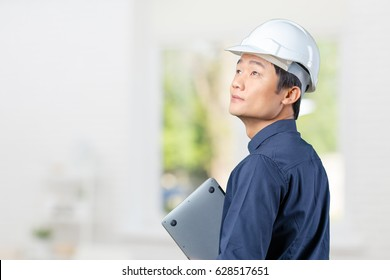 Man asian engineer with laptop