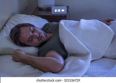 Man asleep in bed