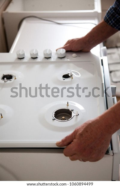 man assembling kitchen