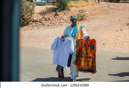 A man from Aswan selling textiles with Pharaonic fees for tourists, Aswan, South Egypt, August 13, 2015