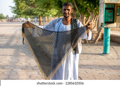 A man from Aswan selling textiles  for tourists, Aswan, South Egypt, August 13, 2015