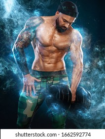 Man athlete bodybuilder. Muscular young fitness sports guy doing workout with dumbbell in fitness gym. Energy and power.
