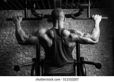 Man Athlete Doing Pull Ups - Chin-Ups In The Gym