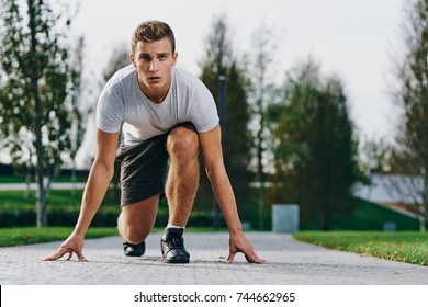 man athlete preparing to run, park, load, training, sport, athletics