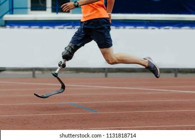 man athlete runner artificial leg limb running in stadium