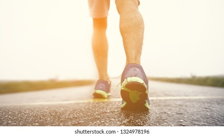 Man athlete running on the road. fitness and healthy lifestyle