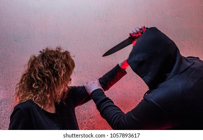 a man attacks a woman with a knife