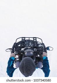 Man in atv quad bike. Winter snow field.