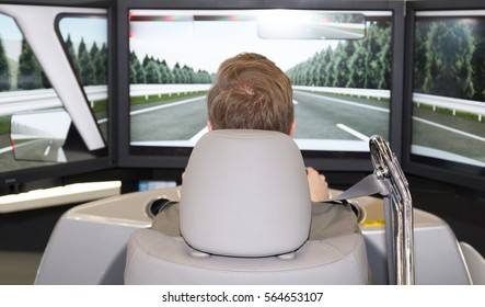 Man in an automotive simulator electric car