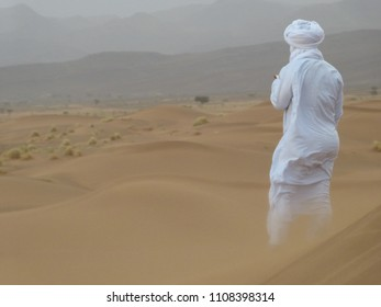 Man awaiting sand storm on a dune in the Sahara