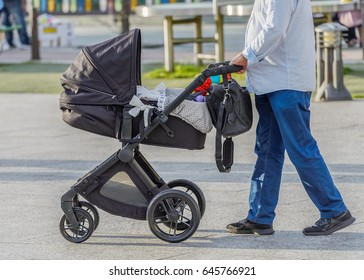 man with a baby stroller on a walk