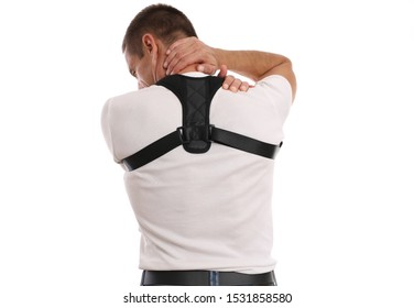 Man with back and neck pain. Poor posture correction. Scoliosis, Kyphosis treatment