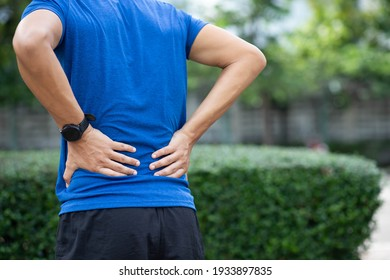 A man back pain after exercise concept.It happens often in athletes practice overtain,Lifting heavy objects or office syndrome.A Muscle inflammation concept.