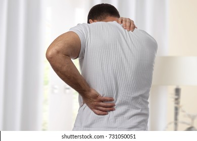 Man with back. Pain relief and health care concept.