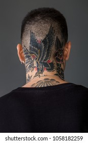 Man back portrait with tattooed neck - Eagle, ship, roses
