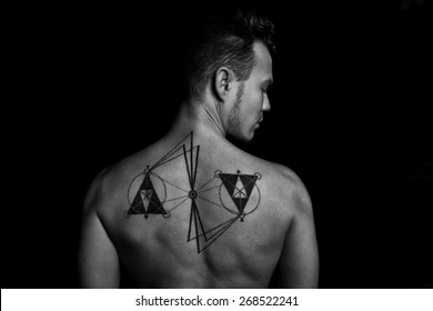 Man back with tattoo in black and white