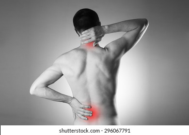 Man with backache. Pain in the man's body. Black and white photo with red dots