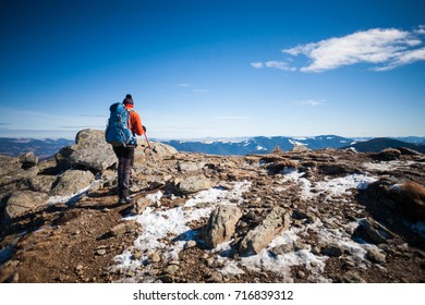 Man with a backpack in the campaign. Mountaineer in the winter in the mountains. Extreme holidays in the mountains.