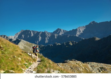 a man with backpack is in the mountains