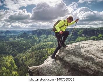 man backpacker running up on mountain top cliff edge. Travel and trail lifestyle concept adventure, outdoor summer vacations