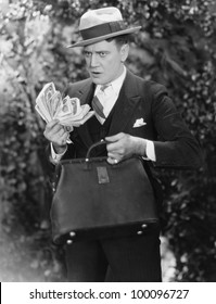 Man with bag full of cash