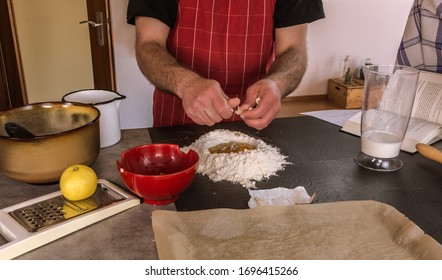 Man bakes a delicious cake - Shutterstock ID 1696415266