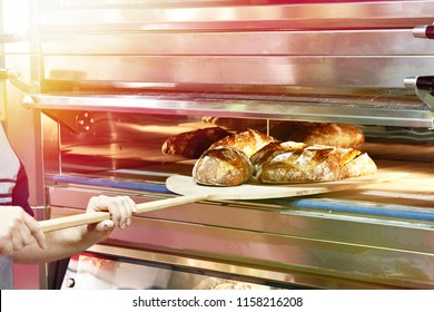 Man is baking bread in the oven