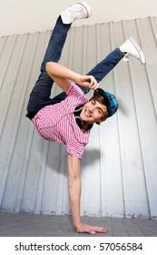 Man Balancing on One Hand