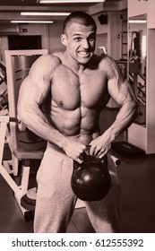 A man with a barbell exercise on biceps