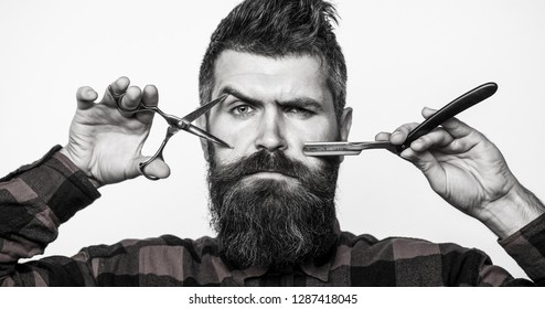 Man in barbershop. Bearded man, lush beard, handsome. Hipster, brutal male.  Mens haircut. Vintage barbershop, barber shop, shaving. Barber scissors. Mens haircut. Black and white.