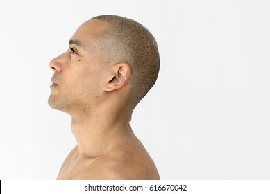 Man bare chest side view studio portrait