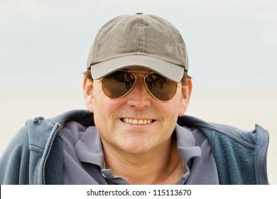 Man in baseball cap and sunglasses