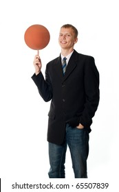 Man with a basketball on his finger