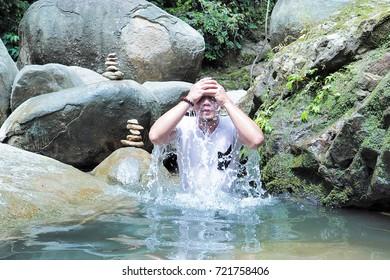 man bath at river in jungle