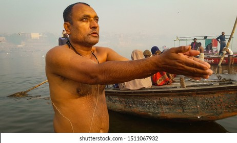 Man bathing in holly ganga river and pay their devotion image is taken at varanasi india on Jan 14 2019. the image is taken at ganga ghat of varanasi showing devotion towards the mother ganga river.