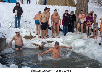man bathing in winter,19/01/2017 Ukraine Lviv, people dive into icy water for baptism