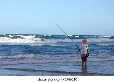 A man beach fishing.