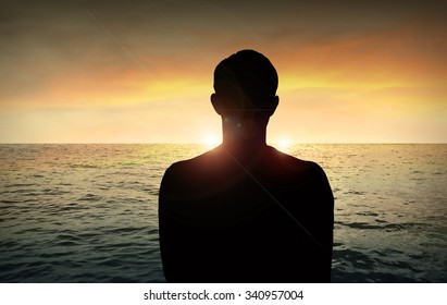 Man in the beach at sunset