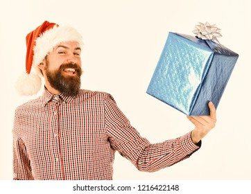 20ae925cfe9bb Man with beard and cheerful face isolated on white background. Santa with  wrapped blue gift
