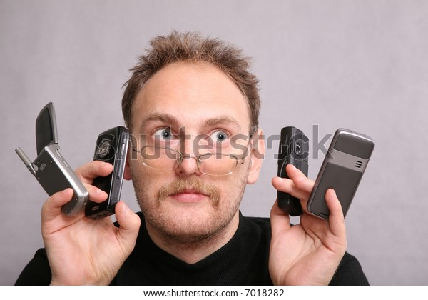 man with the beard and four cell phones