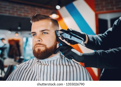 Man with a beard. Hairdresser with a client.